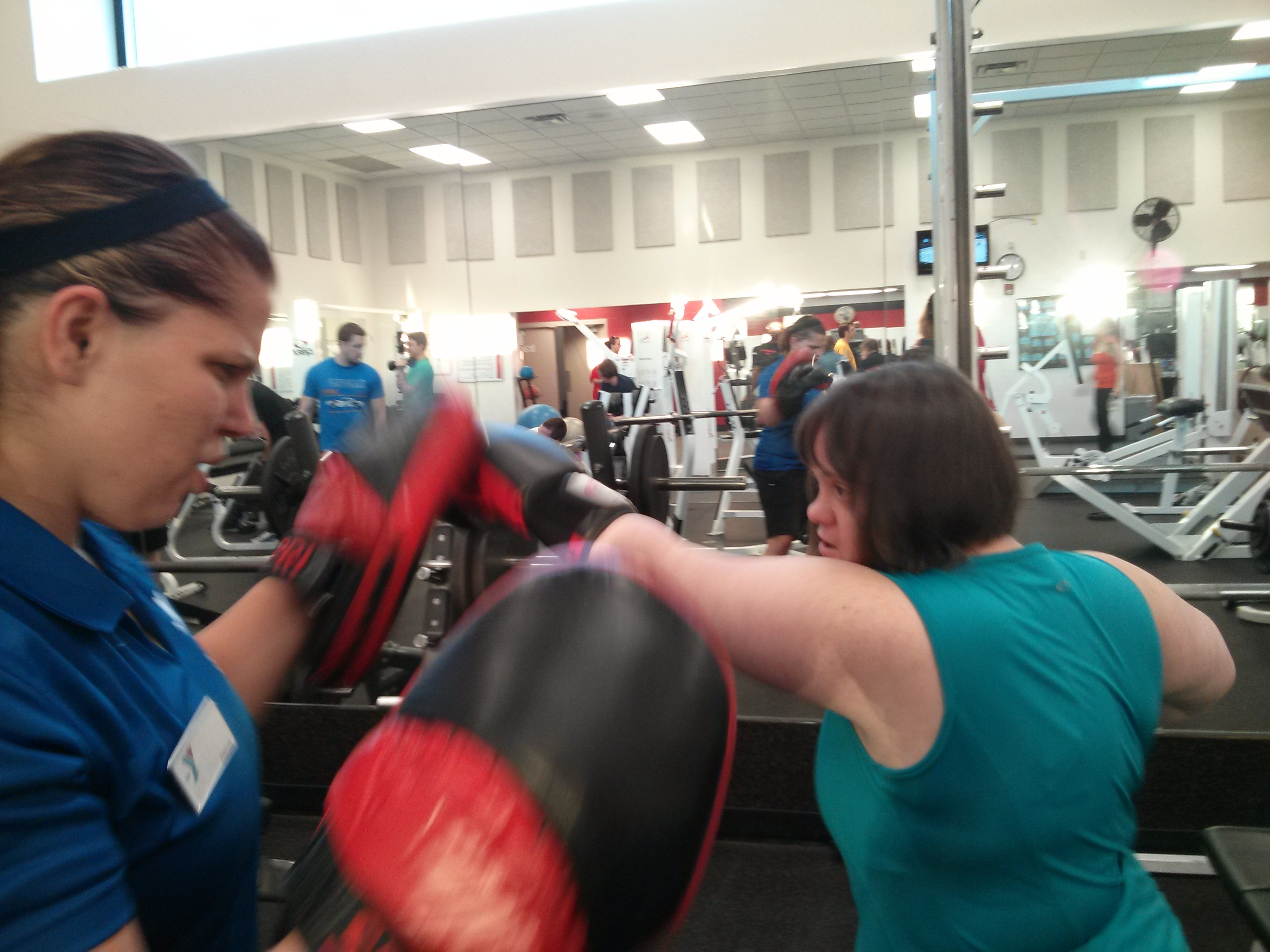 Peggy working out with her trainer.